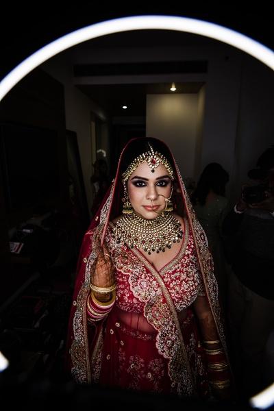 Sukanya looks gorgeous in her red bridal lehenga.