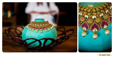 Gold heirloom necklace studded with precious stones and large pearl drops