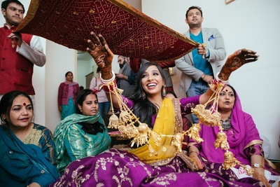 a candid picture of the bride at her chooda ceremony