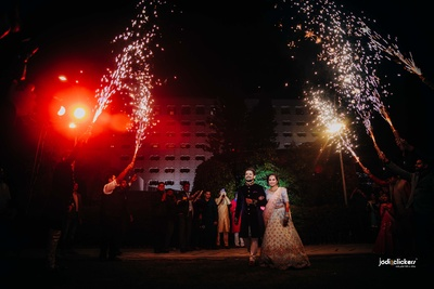 The bride and groom entering the sangeet venue in style with fireworks!