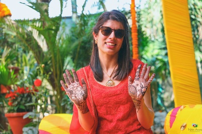 Traditional bride shows off her intricate mehndi design