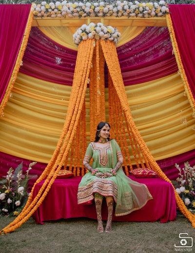 An etheral picture of the bride with an understated yet chic floral decor as the backdrop