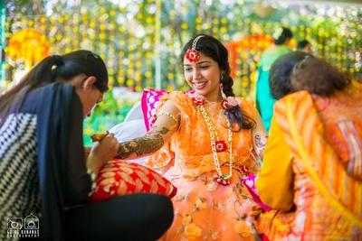 Bride's self designed mehendi outfit, styled fresh flower jewellery