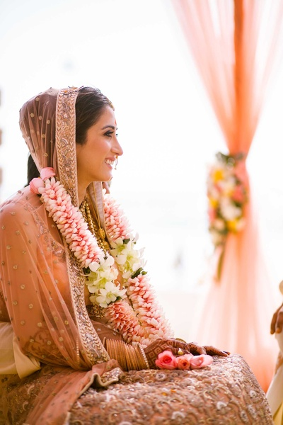 Candid capture of the bride at the wedding mandap