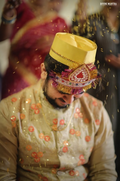 Rice shower over the groom as part of the haldi ceremony!