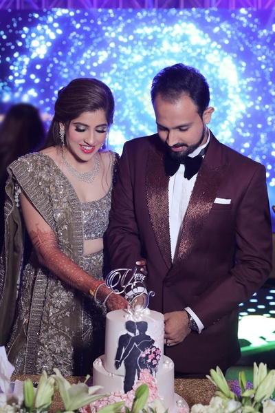 The couple shot during the cake cutting ceremony on their sangeet night.