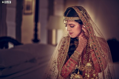 Adorned in gold bridal jewellery for the sikh palace wedding.