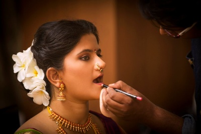 Final touches of lip liner for the Bride-to-be