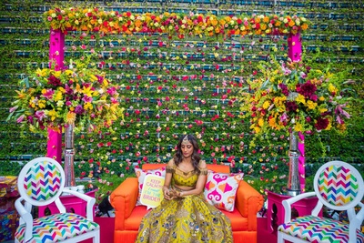 pretty bride in her mehendi outfit for the mehendi ceremony