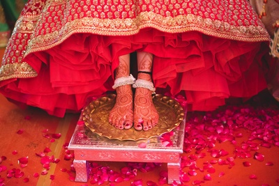Adorned in pretty silver anklets for the wedding day.