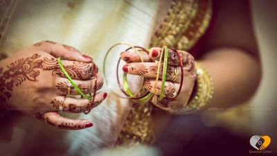 Green and red bangles being set for the bride