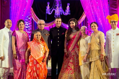 Dressed in pink and black outfits for their pink and purple themed reception ceremony held at Hotel Fairmont, Jaipur