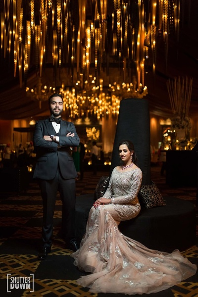 the bride and groom striking a royal pose at their cocktail night