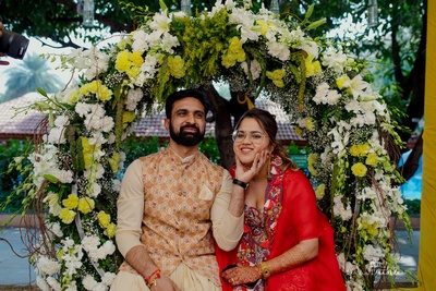 the couple posing at their mehendi ceremony