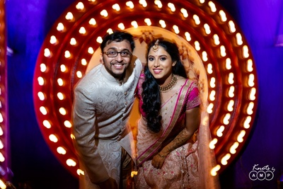 a cute couple picture at the sangeet
