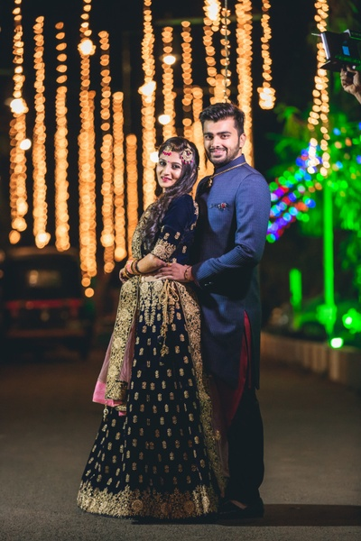 bride and groom posing romantically at their sangeet ceremony