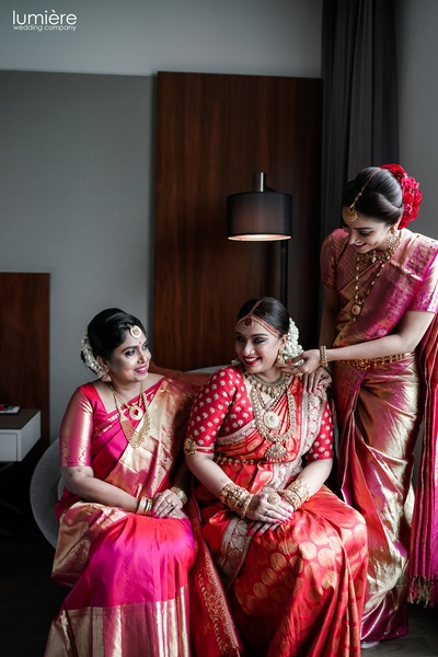 the bride with her sister and her mother