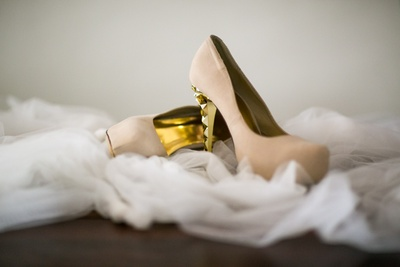 Beige and golden wedding shoes.