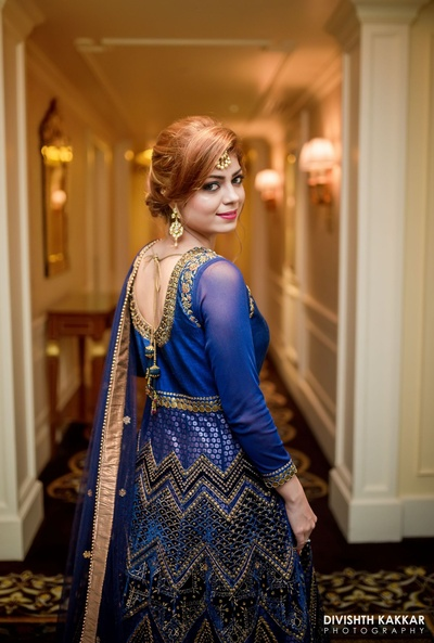 Totally crushing over this blue and copper work anarkali paired with minimal makeup and maang tikka.