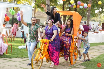 Rickshaw at the party decorated with genda phool.
