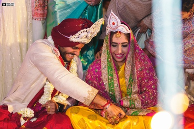 a candid capture of the couple  from the Odiya wedding