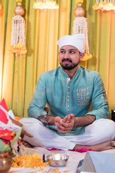 The groom flaunts a blue personalised kurta post the haldi ceremony.