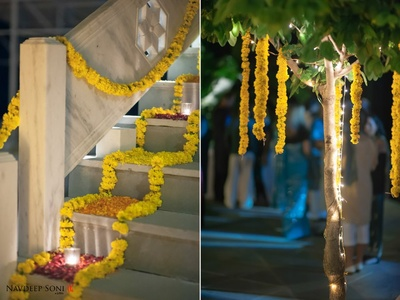 Wedding venue decorated with Marigold strings, fairy lights, tea light candles, and flower petals