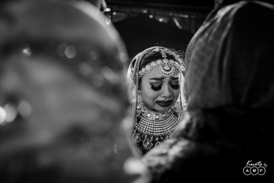 The bride getting emotional durting her vidaai ceremony.