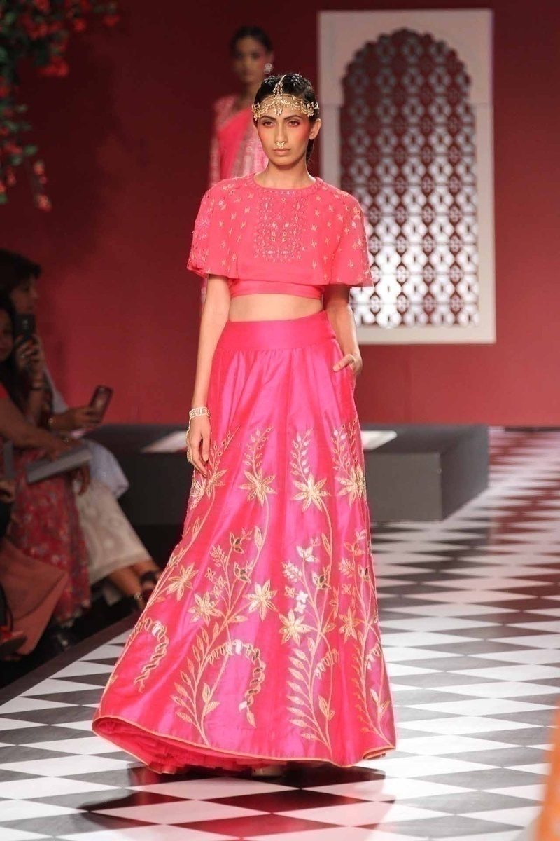 Anita Dongre does pink right! Pairing the classic bridal saree and lehenga with jackets and capes - Geometrical figures and nature inspired patterns dominated the pink section!