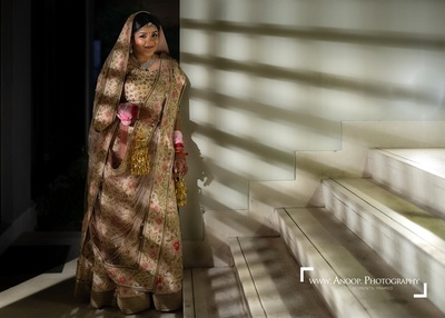 the bride in an ivory lehenga for her wedding