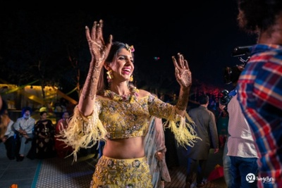 The bride having a gala time her mehendi ceremony.