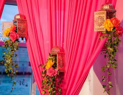 hanging lanterns and pink drapes decor for the garba/sangeet night