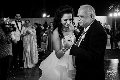 a black and  white picture of the bride sharing a dance with her fathe