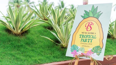 The couple hosted a tropical themed party for friends and family.
