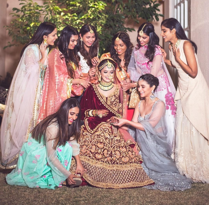 4. The bride squad making sure the bride looks just PERFECT for her D-day!