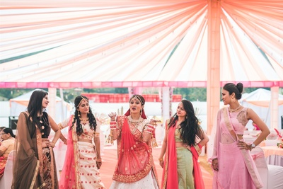 the quirky bride with her bridesmaids at the wedding