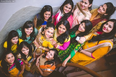 Colorful Bride and Bridesmaids all set for Radha Krishna themed pre wedding ceremony.