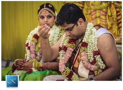 Unique wedding garland made with Rajnigandhas, and lotus buds