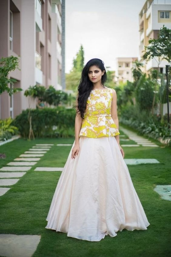 7b7456a710 This simple lehenga 2018 with flowy cream coloured bottom and printed yellow  peplum top is a great option to wear on your haldi or mehendi ceremony.