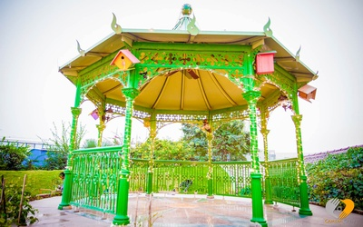 Green dome shape canopy with arbour