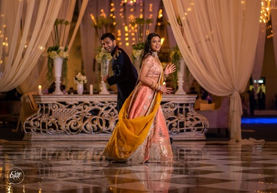 the quirky couple posing at their sangeet