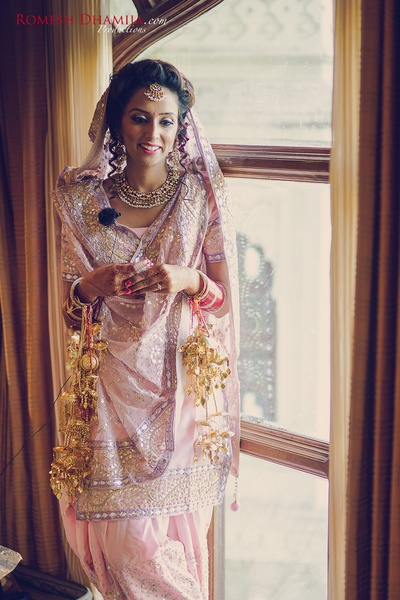 Wearing light pink and mauve salwar suit with minimal jewellery and brilliant makeup and hairdo!