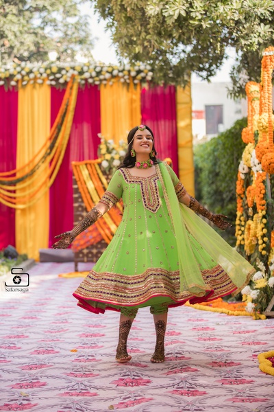 The stunning bride twirling in her pretty parrot green lehenga!