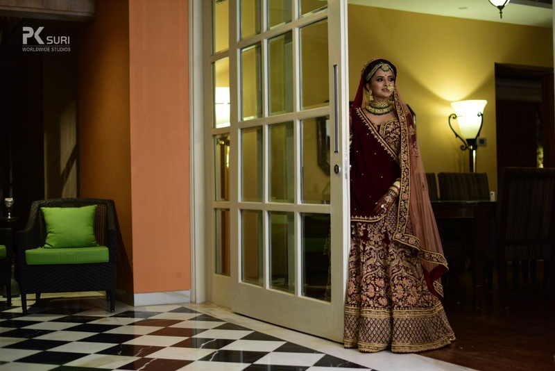 2. The maroon leghenga coupled with emerald and gold jewellery looks simply ravishing!