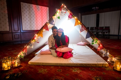 super cute couple shot under a tent at the pyjama party