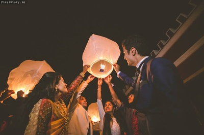 Releasing sky lanterns post wedding ceremonies as a sign of good luck.