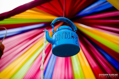 Quirky tea kettle decor for the mehendi ceremony.
