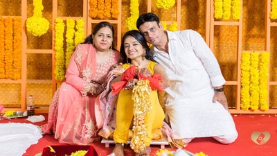Priyanka posing with her parents for a photo.
