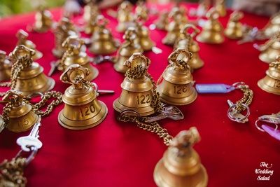 Cute bells with the room numbers engraved are ready for the guests.