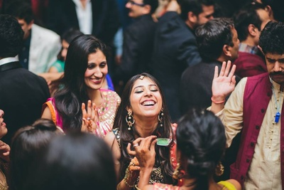 Happy and cheerful bride at her sangeet ceremony.